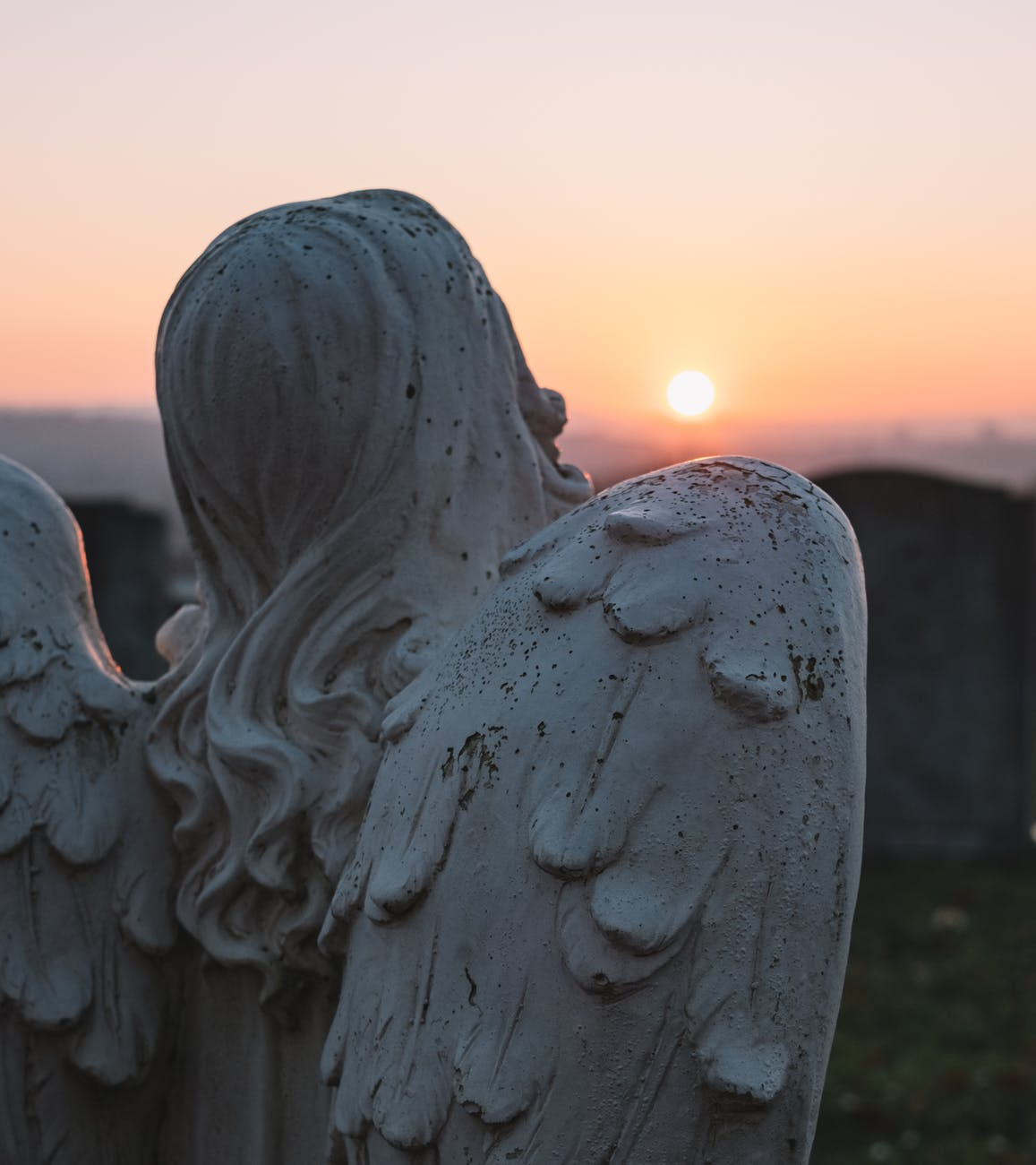 angelic statue and sunset scenery